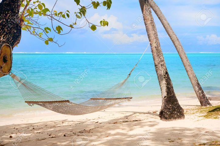 10439816-tranquil-scene-with-tropical-beach-and-hammock-stock-photo-relaxing